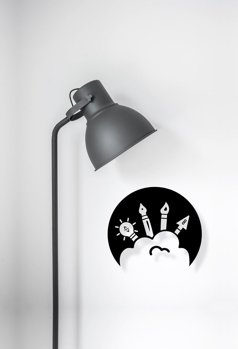 The Visual Row logo under a lamp